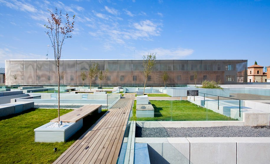Architects Use Transparent Metal Mesh On Hotel With Traditional Spanish Monastic Design